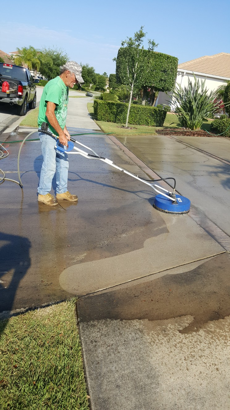 Driveway and sidewalk cleaning looks GREAT!